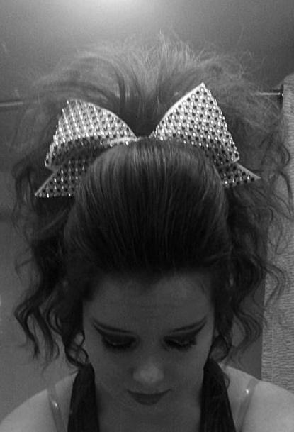 Teased ponytail with poof cheer hair