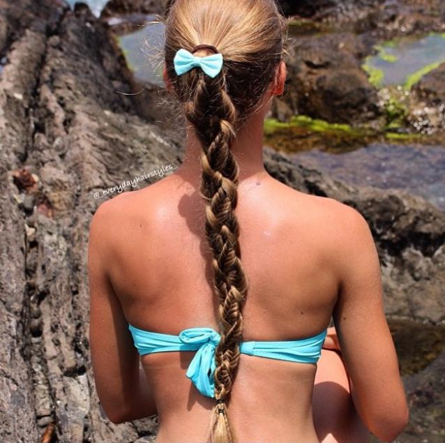 Four strand braid with two fishtail braids