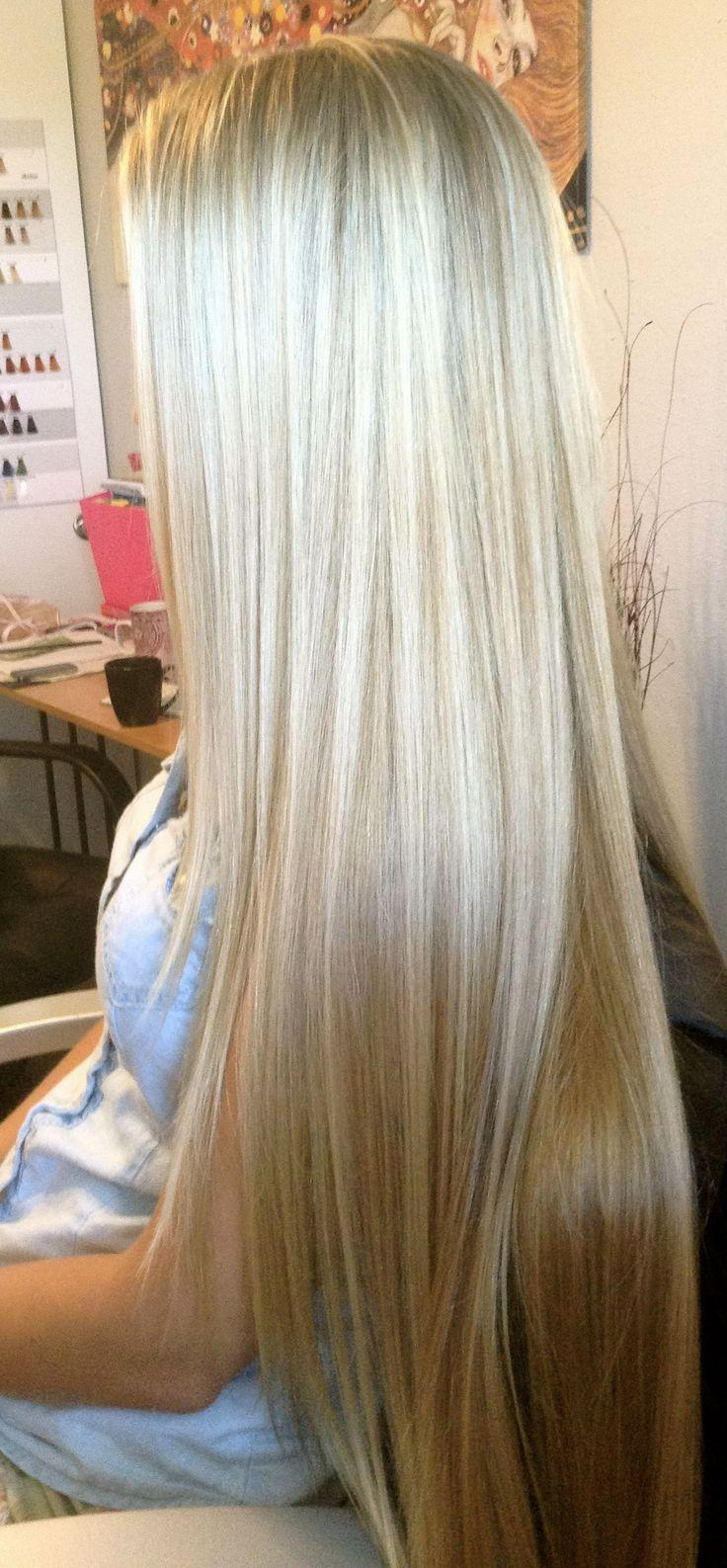 layered straight blonde hairstyle